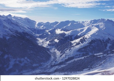 Ski slopes and beautiful winter landscape in the Alps, Samnaun Ischgl, Tirol, Austria, clouds sunshine and happiness