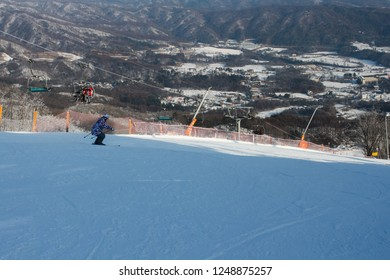 Ski slopes, people are skiing slope downhill, it is a beautiful white slope, winter in Korea.