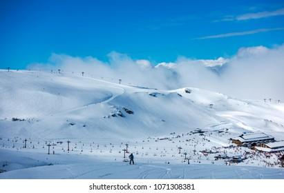 Ski slopes of Pradollano ski resort in Sierra Nevada mountains in Spain