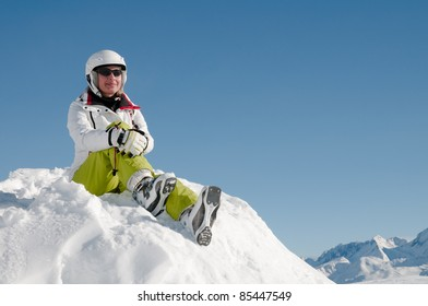 Ski, snow, sun and fun - happy skier in winter resort (space for text )