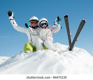 Ski, snow, sun and fun - skiers on winter vacation