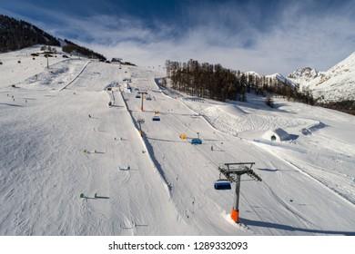 Ski station, skiers on the snow.  Winter in Valtellina