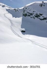 Ski traces in alpine fresh snow.