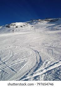 Ski track down the mountain