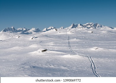 Ski tracks in Jotunheimen nationalpark looking towars mountains.