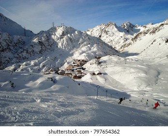 Ski village in the alps with skiers
