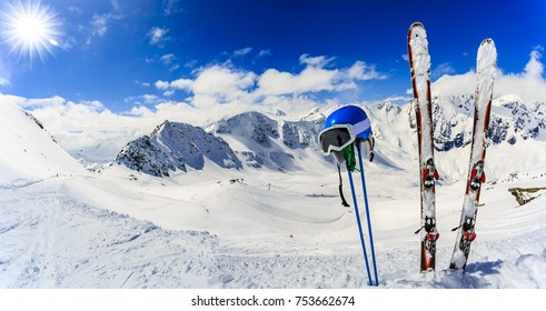 Ski in winter season, mountains and ski touring backcountry equipments on the top of snowy mountains in sunny day. South Tirol, Solda in Italy.