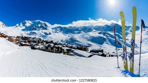 Ski in winter season, view from ski run at mountains and Val Thorens resort in sunny day in France, Alps.