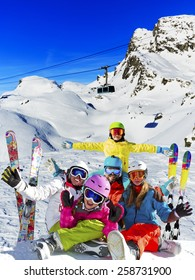 Ski, winter, snow - family enjoying winter vacation in Verbier, photo manipulation: Only four model releases are needed - the same child on the photo. - Shutterstock ID 258731900