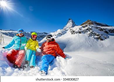 Ski, winter, snow - family enjoying winter vacation in Zermatt, Switzerland
