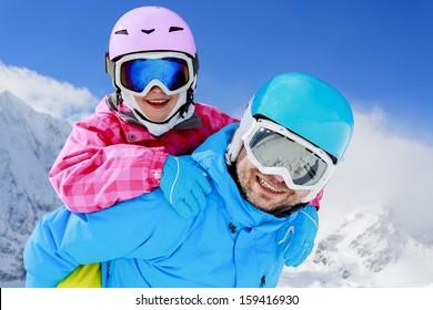 Ski, winter, snow, skiers, sun and fun - family enjoying winter vacations