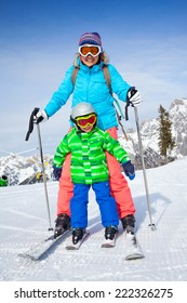 Ski, winter, snow, skiers, sun and fun - Family - mother and son enjoying winter vacations.