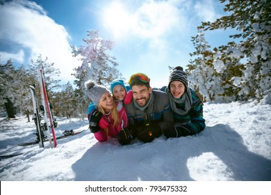 Ski, winter, snow, sun and fun â?? happy family enjoying in winter vacations