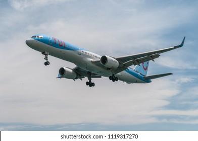 Skiathos, Greece. 15 June 2018: TUI airlines 757 lands at Skiathos, Greece. Skiathos airport is known as the 2nd st. Maarten due to its short runway.