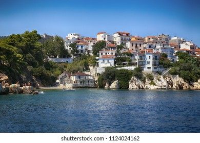 Skiathos, Greece - August 17, 2017: View from boat Skiathos town, on old part of on Skiathos Island in Greece. It is one most beautiful Greek island, Skiathos island on August 17, 2017.