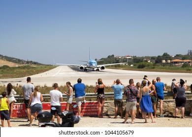 SKIATHOS, GREECE - AUGUST 18, 2017. Edge of the runway where tourists flock to see aeroplanes land, Skiathos Town, Greece, August 18, 2017.