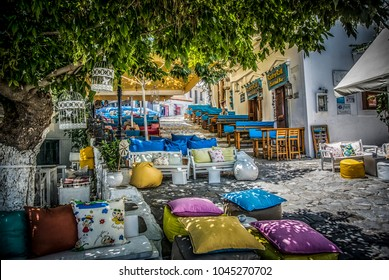 Skiathos, Greece – July the 1st 2015: Colorful pillows at street cafes at the island of Skiathos.