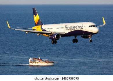 Skiathos, Greece – July 28, 2019: Thomas Cook Airbus A321 airplane at Skiathos airport (JSI) in Greece.