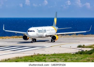 Skiathos, Greece – July 30, 2019: Thomas Cook Airlines Scandinavia Airbus A321 airplane at Skiathos airport (JSI) in Greece.
