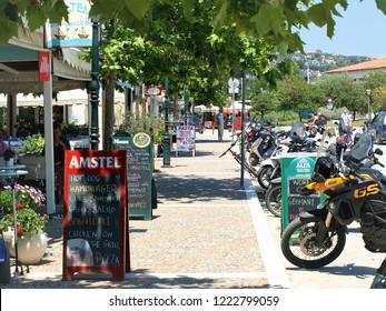 Skiathos, Greece. June 16, 2014.  Bars and motorbikes on the seafront of Skiathos town on the Island of Skiathos in the Greek Islands, Greece.