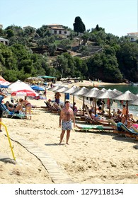 Skiathos, Greece. June 16, 2014. Holidaymakers enjoying the sunshine and Achladia beach on the island of Skiathos in Greece.