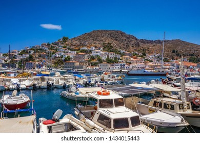 SKIATHOS, GREECE - JUNE 2019: The blue sea with yachts and boats on the water in Skiathos island. The old port in Skiathos against a deep blue sky. Sporades, Greece, Europe