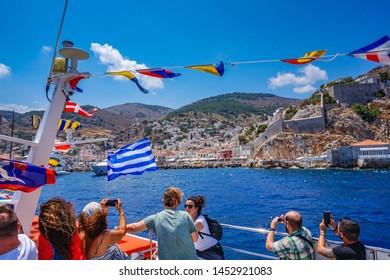 SKIATHOS, GREECE - JUNE 2019: People visit the beautiful Greek island Skiathos and the old port. Sporades, Greece, Europe