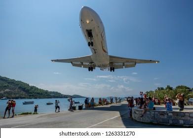 Skiathos, Greece - September 07 2018: A Fokker 70 plane landing low over people at Skiathos Airport