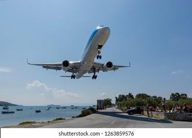 Skiathos, Greece - September 07 2018: A  Boeing 757 plane landing low over people at Skiathos Airport
