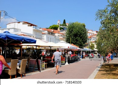 Skiathos, Greece. September 10, 2017. The town front and the seafront tavernas in the quiet of the morning at Skiathos town on the Island of Skiathos in Greece.