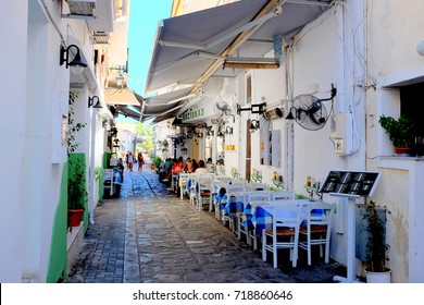 Skiathos, Greece. September 13, 2017.  Tavernas and restaurants on the back streets of Skiathos town on the Island of Skiathos in Greece.