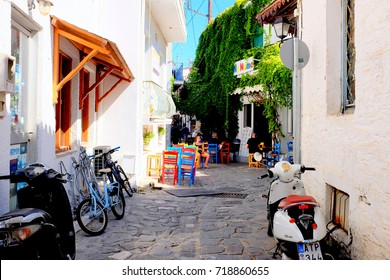 Skiathos, Greece. September 13, 2017.  A taverna called No Name with colored chairs and tables in a back street in Skiathos town on the Island of Skiathos in Greece.