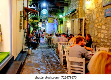 Skiathos, Greece. September 13, 2017.  Night life on the back streets of Skiathos town with pubs and restaurant on the Island of Skiathos in Greece.