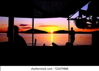 Skiathos, Greece. September 13, 2017.  A beautiful red sunset taken from the taverna on Tsougrias beach on the Island of Megali Tsougrias at Skiathos in Greece.
