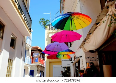 Skiathos, Greece. September 14, 2017.  A shop selling colorful parasols displayed hanging outside the shop in a back street at Skiathos town on the Island of Skiathos in Greece.