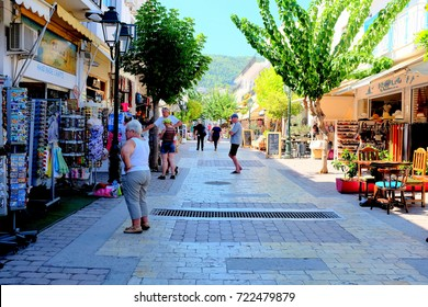 Skiathos, Greece. September 15, 2017. Holidaymakers and tourists browzing and shopping on Papadiamanti street the main street in Skiathos town on the Island of Skiathos in Greece.