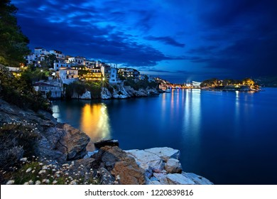 SKIATHOS ISLAND, NORTHERN SPORADES, GREECE- June 24, 2018. Night view of Plakes, the oldest neighborhood of Skiathos town. To the right, you can see Bourtzi castle.