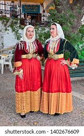 SKIATHOS ISLAND, NORTHERN SPORADES, MAGNESSIA, GREECE - June 23, 2018. Women from Skiathos wearing traditional costumes of the island. Photo taken at the Old Port of Skiathos town.