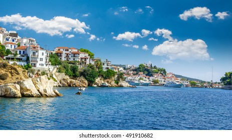 Skiathos town on Skiathos Island, Greece. Beautiful view of the old town with boats in the harbour.