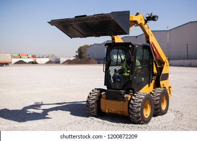 Skid loader or bobcat standing up position