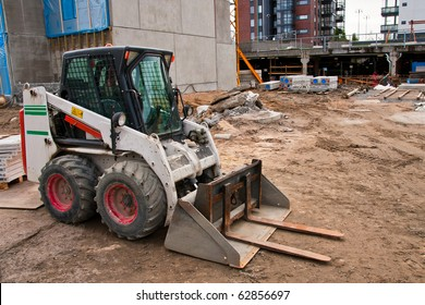 Skid loader on construction site
