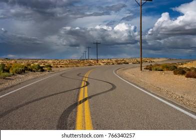 Skid marks on desert road, Initial Point area, Southwest Idaho in September, 2017