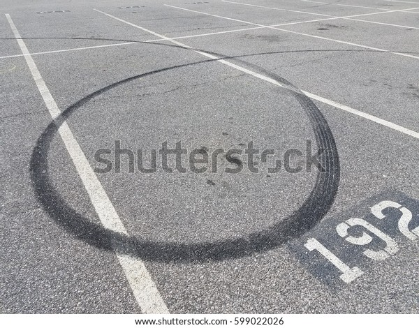 skid marks in parking space 192