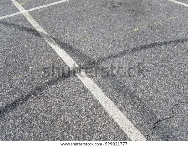 skid marks in a parking space