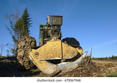 Skidder with claws on a clear cut