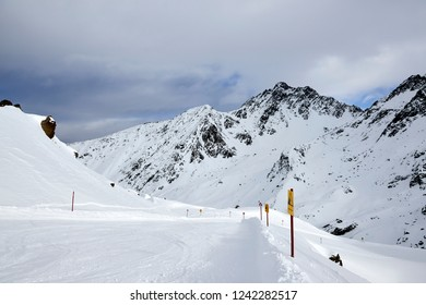 skie area with signs in snowy mountains at austria ischgl