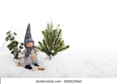 Skier and Christmas tree in the snow