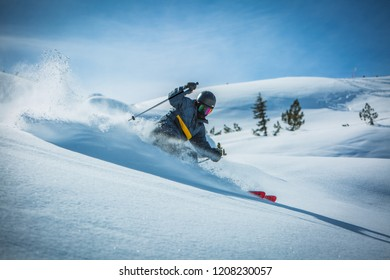 Skier enjoying a deep powder turn