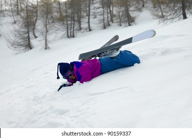 Skier fallen over in the snow