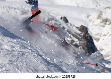 skier falling down the hill on the clouds of snow powder